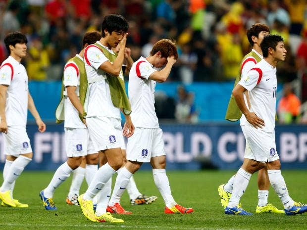 South-Korea-players-look-dejected-after-a-0-1-defeat-to-Belgium-in-the-2014-FIFA-World-Cup.jpg