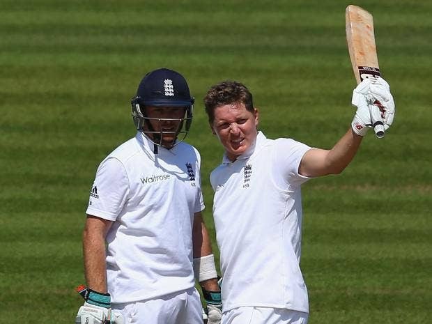 Gary-Ballance-(R)-of-England-raises-his-bat-after-reaching-his-150-alongside-Ian-Bell-during-day-two-of-the-3rd-Investec-Test-match-between-England-and-India.jpg