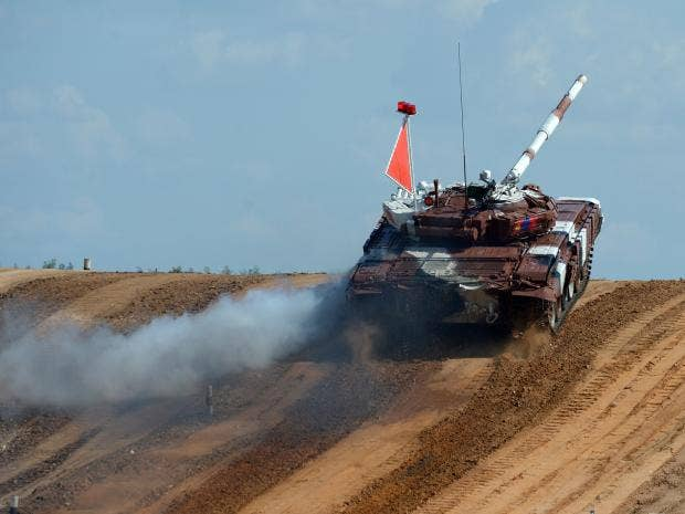 CaptionThe-tank-of-team-Mongolia-competes-during-tank-biathlon,-a-paramilitary-international-competition-with-armour-races-and-precision-gunnery-near-Alabino,-outside-Moscow,-on-Au_1.jpg