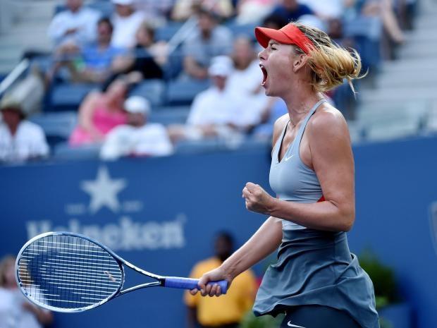 Maria-Sharapova-of-Russia-reacts-to-winning-a-game-against-Alexandra-Dulgheru.jpg