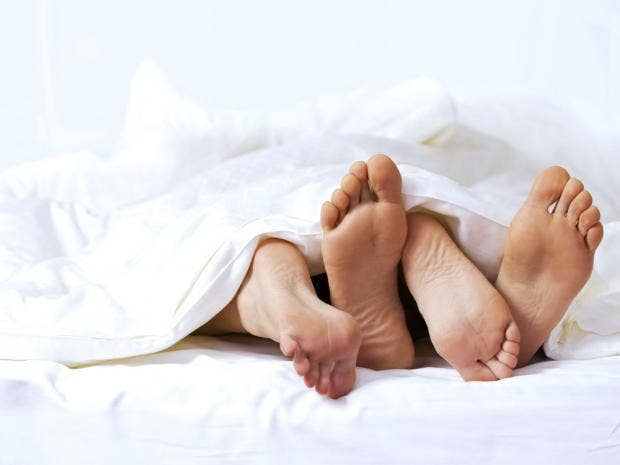 COUPLE-FEET-BED.jpg