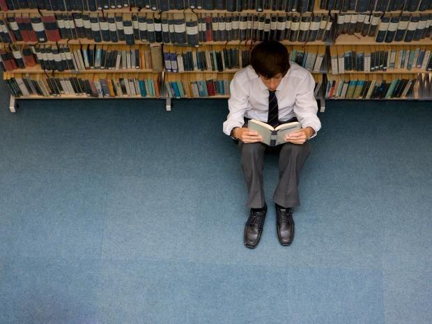 male-student-reads-book-alamy.jpg