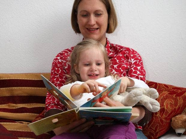 mom-reading-book-to-child-bedtime-Getty.jpg