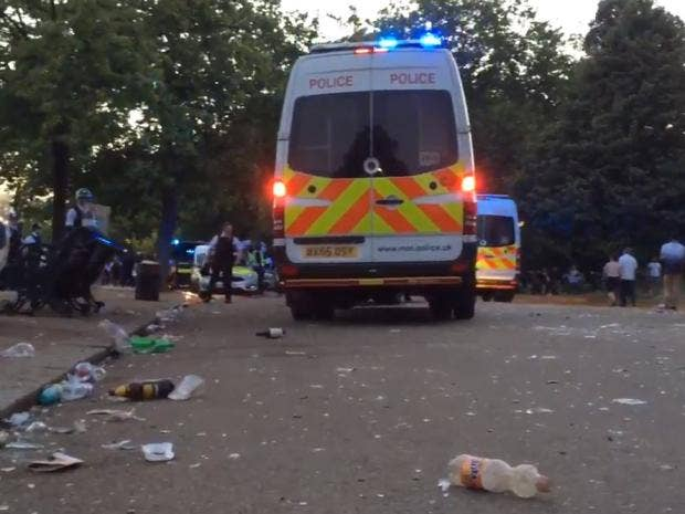 Police officer among three people stabbed when water fight crowd turns hostile