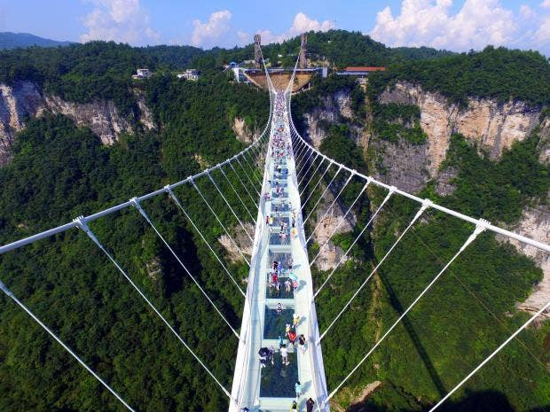 China opens world's highest and longest glass bridge