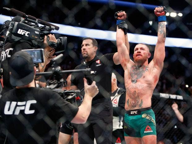McGregor beats Diaz in UFC 202 bloodbath