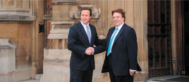 David Cameron welcoming John Howell, the newly elected MP for Henley, yesterday