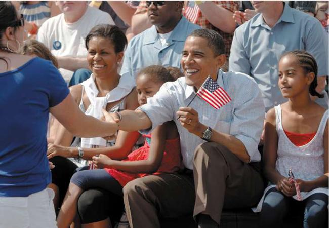 Waving the flag: Obama and family celebrating the Fourth of July in the traditional style
