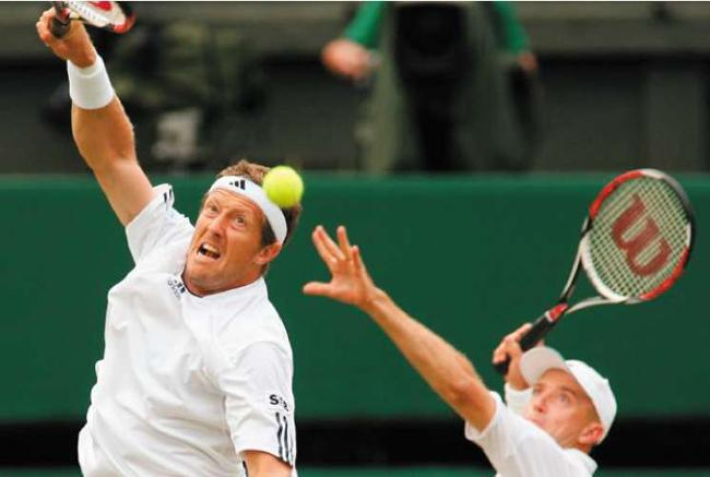 Mix-up doubles: Jonas Bjorkman (left) and Kevin Ullyett hit out during a doubles final loss to Daniel Nestor and Nenad Zimonjic