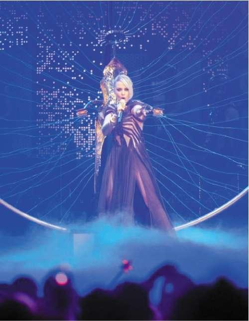 Kylie parades her Celine Dion persona at the start of her new tour