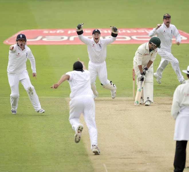 Monty Panesar joins team-mates Ian Bell (left) and wicketkeeper Tim Ambrose for a typical celebration after bowling Neil McKenzie