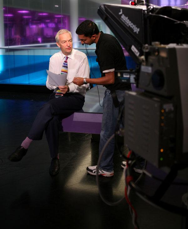 Jon Snow and colleagues in the 'Channel 4 News' room preparing for the evening broadcast