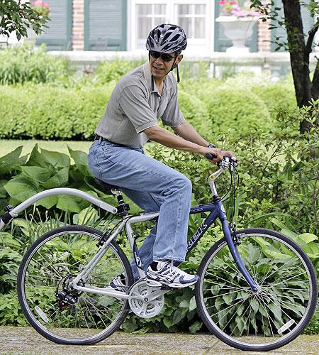On his bike: Barack Obama out for a ride in Chicago