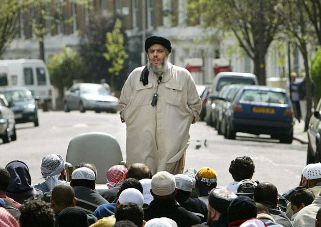 Abu Hamza, pictured addressing his followers outside Finsbury Park mosque in north London