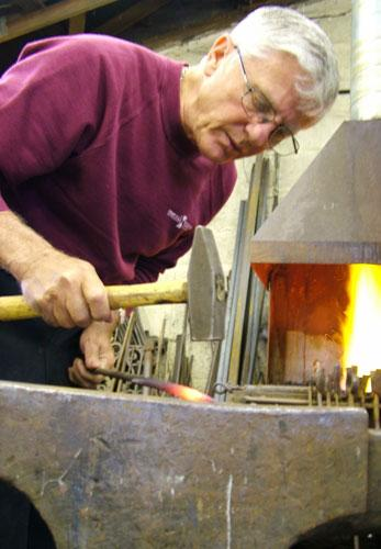 Metal man: Don Barker at work in his forge
