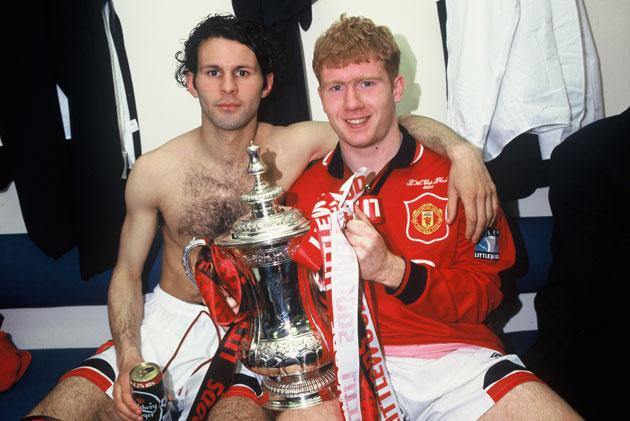 Ryan Giggs and Paul Scholes of Manchester United celebrate in the dressing room with the FA Cup after the Liverpool v Manchester United FA Cup Final between Liverpool v Manchester United at Wembley Stadium on May 11, 1996 in London. Liverpool 0 Manchester