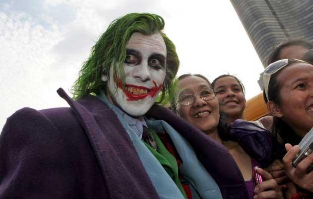 As seen on screen: a fan dresses up as The Joker for a screening of The Dark Knight