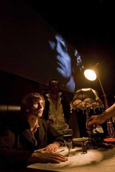 Screen time: Ben Whishaw (left) and Jamie Ballard perform live, while their celluloid counterparts interact in the background