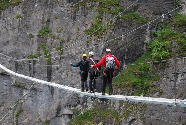 High times: hikers make their way across a rope bridge section of the new via Ferrata