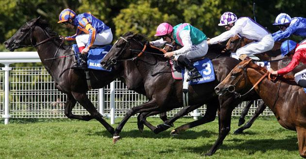 Johnny Murtagh keeps Halfway To Heaven ahead of the pursuing pack for victory in Saturday's Nassau Stakes at Goodwood