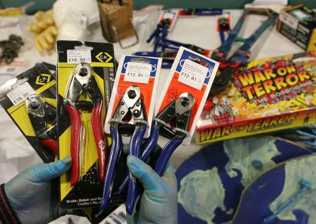 Police display confiscated items, including a 'War on Terror' board game