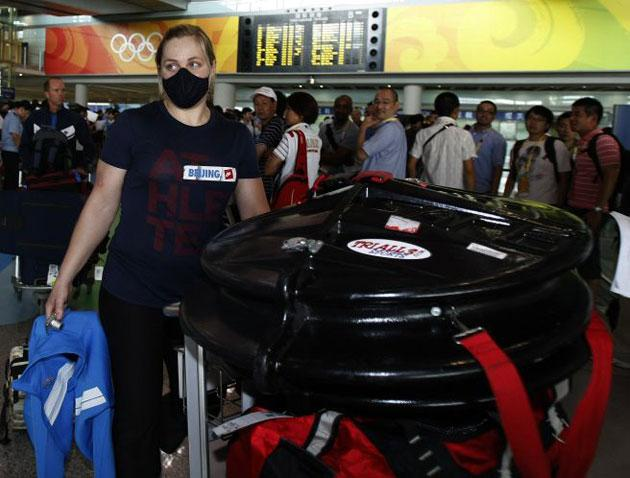 An American cyclist arrives in Beijing wearing a face mask in an attempt to protect against the impact of smog