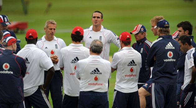 Coach Peter Moores (left, facing camera) listens as new England captain Kevin Pietersen (centre, facing camera) speaks to the players during a nets session at The Oval yesterday