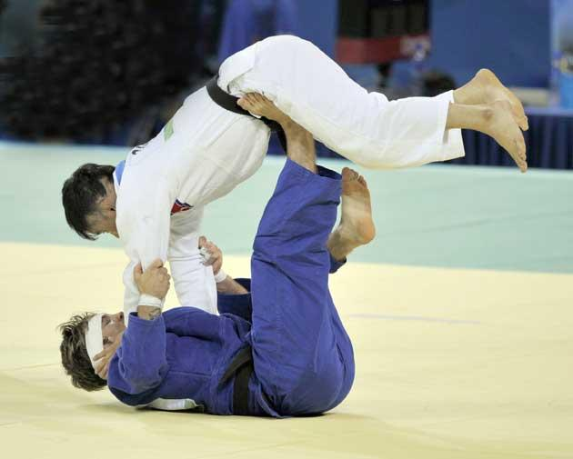 Craig Fallon (bottom) gets to grips with North Korea's Jin Kyong Kim during his victory in the Under-60kg repêchage