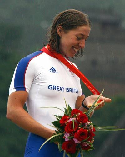 Cooke receives her medal on a rain lashed day