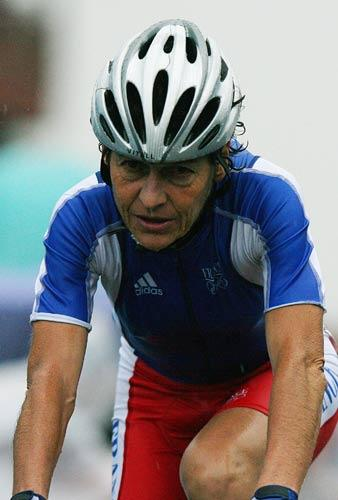 France's 50 year old Jeannie Longo crosses the finish line in the women's Road Cycling event in Beijing