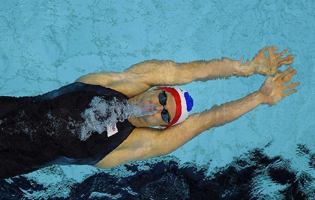 Liam Tancock of Britain swims in his men's 100 meters backstroke semi-final