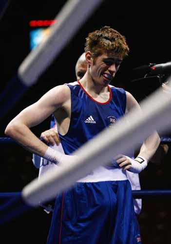 Joe Murray of Great Britain grimaces after his defeat to Gu Yu of China in the Men's Bantam (54kg) fight