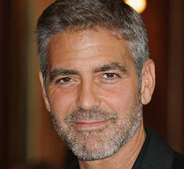 George Clooney has bought the film rights to a book about Osama Bin Laden's driver Salim Hamdan