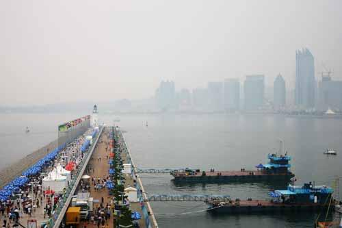 A general view of the main breakwater as light wind causes a postponement of competition of races at the Qingdao Olympic Sailing Center