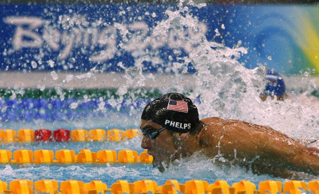 Michael Phelps competes during the American team's victory in the men's 4x100 meters medley relay swimming final