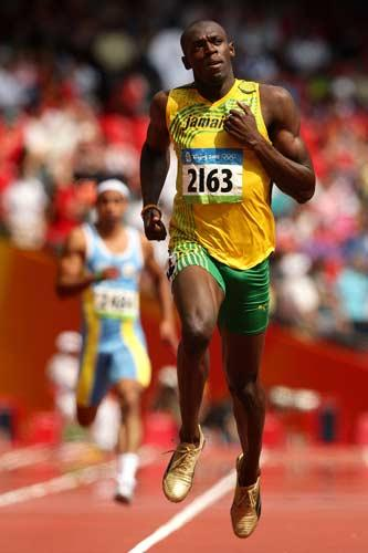 Bolt looks relaxed as he gets his 200m bid underway with second place in the heats