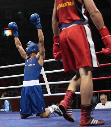 Degale (in blue) progesses to the semi-finals ensuring a trio of British medals in the boxing