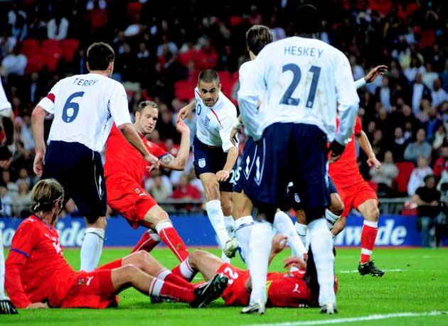 Joe Cole (centre) scuffs in England's injury-time equaliser through a crowded goalmouth in last night's friendly against the Czech Republic at Wembley