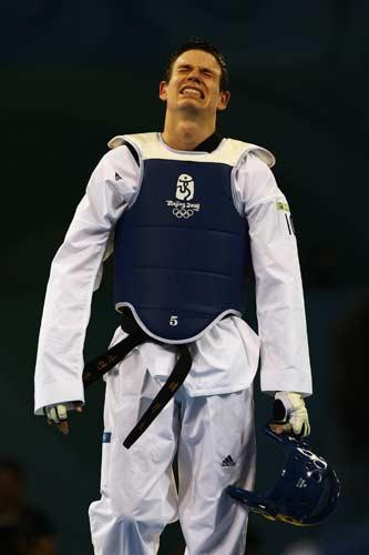Aaron Cook reacts after defeat in the Men's Taekwondo 80kg semi-final fight against Mauro Sarmiento of Italy