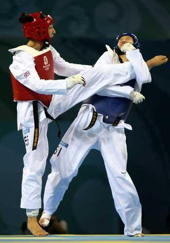 Sarah Stevenson (left) connects with Chen Zhong's head during the controversial over-67kg quarter-final; Stevenson went on to win a bronze medal