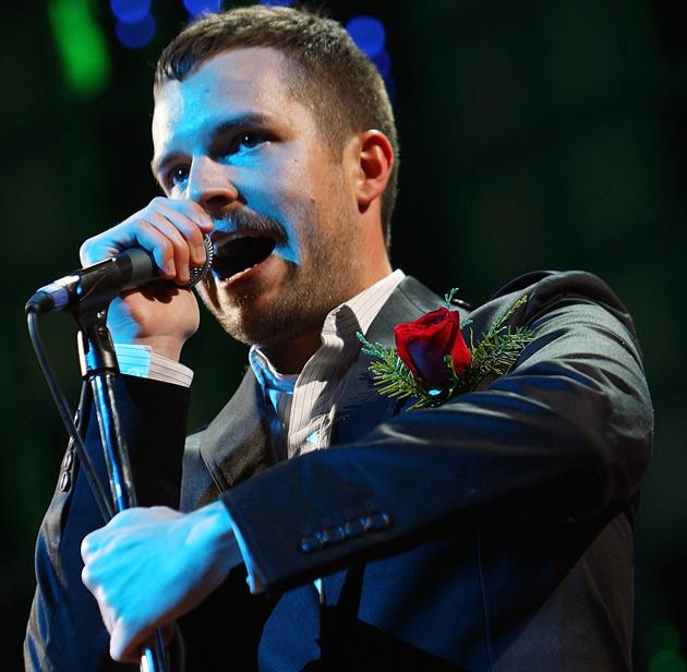 Killers frontman Brandon Flowers fumbled with the basics, often singing out of key and away from his microphone.