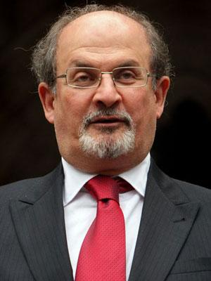 Salman Rushdie speaks to reporters after leaving the High Court