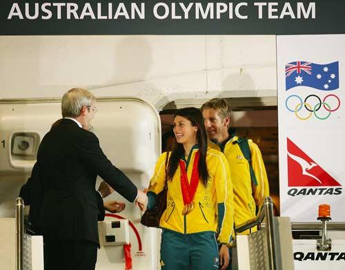 Australian Prime Minister Kevin Rudd greets Stephanie Rice as the Australian Olympic team arrive home at Sydney Airport following the Beijing Olympics