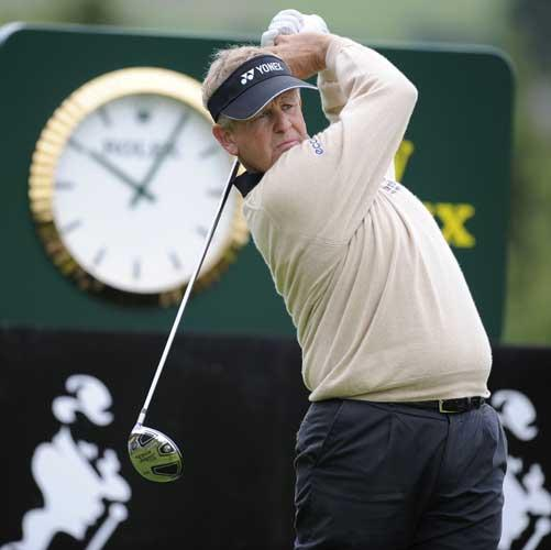 Colin Montgomerie, pictured teeing off on the 18th at Gleneagles yesterday, is involved in a squabble with fellow Ryder Cup wild-card hope Ian Poulter