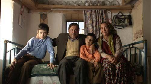 Family bonds: Bulent Emin Yarar (centre) plays the imam in a Turkish mountain village whose son Omer plans to kill him for doting on his infuriatingly angelic younger brother