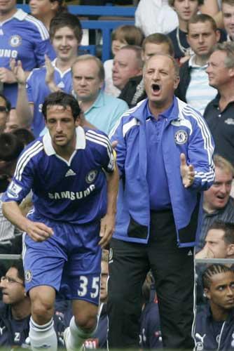 The Chelsea manager, Luiz Felipe Scolari (right), celebrates the goal by Juliano Belletti (left) that put his team ahead against Tottenham Hotspur at Stamford Bridge yesterday