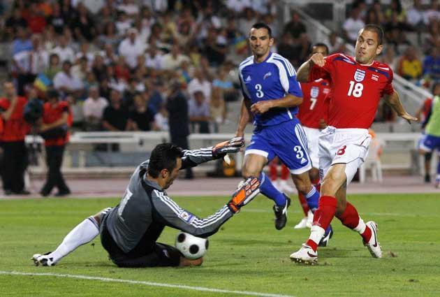 Joe Cole slides the ball under the Andorran goalkeeper Koldo for his second goal in Barcelona