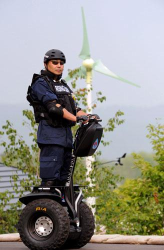 Security staff used Segways at the G8 Summit Media Centre in Rusutsu, Japan