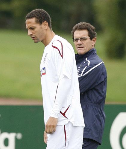 Fabio Capello watches Rio Ferdinand in training. The England centre-half's neck and back injuries have responded to treatment and he is expected to play against Croatia tomorrow