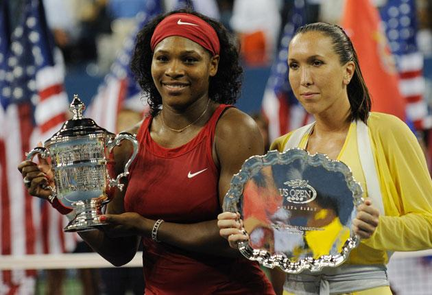 Serena Williams and Jelena Jankovic of Serbia receive their trophies after the women's final at the US Open tennis tournament in New York